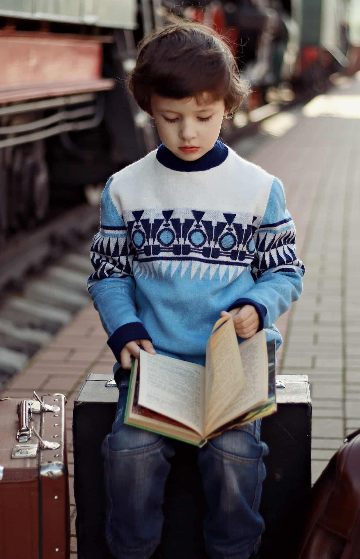 How to Encourage Reading for Children - Reading while waiting for a train. How to develop reading habit in kids Child reading